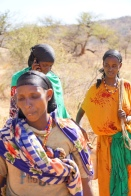During her trek to the taxi area, Dhaki occasionally pass other women and community members heading to or from town, or on various chores.