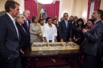 """President Barack Obama and Members of Congress view """"Lucy,"""" the 3.2 million year old fossilized bones of a human ancestor, at the National Palace in Addis Ababa, Ethiopia, July 27, 2015. Zeresenay Alemseged, an Ethiopian paleoanthropologist, explains the fossil. (Official White House Photo by Pete Souza)"""