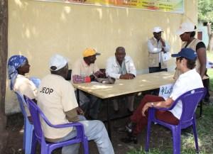 Ambassador Haslach at JOEP Food Distribution Point learning about complaint handling mechanisms at the facility አምባሳደር ሃስላክ በምግብ ማከፋፈያ ማዕከል ተገኝተው ስለ ቅሬታ አፈታት መንገዶች ገለጻ ሲሰጣቸው