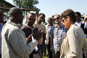 A local administrator explains to Ambassador Haslach about interventions in the area by USAID and GOAL Ethiopia የወረዳው አመራር አባል የአሜሪካ ዓለም አቀፍ ልማት ማህበርና ጎል ኢትዮጵያ በወረዳው ስለሚሠሯቸው ሥራዎች ለአምባሳደር ሃስላክ ማብራሪያ ሲሰጡ