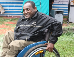 Melesse Yohannes uses his Rough Rider wheelchair to go out and buy supplies for his shoe making and repair shop.