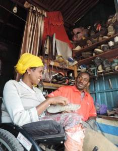 Looking forward to the business that rainy season brings, Senait Melesse brings broken shoes back to life in her own shop.