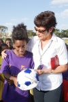 Following her game at the Kembata annual event, one of the players receives a soccer ball from U.S. Ambassador to Ethiopia Patricia Haslach. The teams consisted of uncut girls (girls who have not undergone female genital mutilation) in the Durame area. KMG started its annual event to celebrate uncut girls in 2004 to celebrate and honor the daring young pioneers—the uncut girls—who stood against the tides.