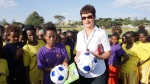 U.S. Ambassador to Ethiopia Patricia Haslach gives soccer balls and books about soccer to players on the competing teams. The teams consisted of uncut girls (girls who have not undergone female genital mutilation) in the Durame area.