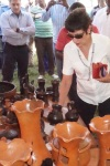 U.S. Ambassador to Ethiopia Patricia Haslach looks at some of the pottery on display at the Kembata annual event