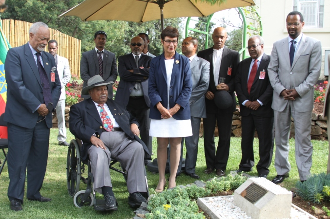 Lij Daniel Jote Mesfin, President of the Ethiopian Patriots Association, former President of EFDR Girma Woldegiorgis and Ambassador Patricia Haslach  dedicate a reading garden in honor of  Colonel John Robinson, who helped found the Ethiopian Air Force, February 2015